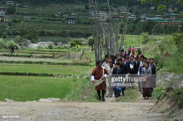 Japanese Princess Mako walks through a farming area in Chukha village on the outskirts of Paro on her visit to Bhutan on June 5, 2017. Japanese...