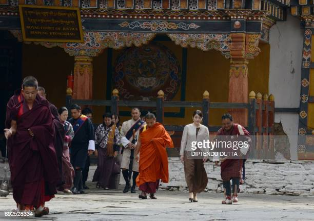 Japanese Princess Mako walks through Rinpung Dzong on the outskirts of the Bhutanese town of Paro on June 5 2017 Japanese Princess Mako the oldest of...