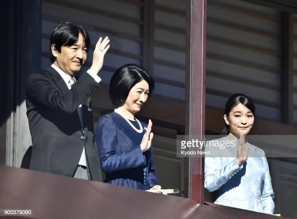 Japanese Princess Mako waves to wellwishers alongside her parents Prince Akishino and Princess Kiko at the Imperial Palace in Tokyo on Jan 2 2018...