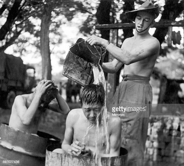 Japanese Prisoners of war are washed by Lance Corporal Smith after they were taken prisoner by British forces during the last stages of the Japanese...