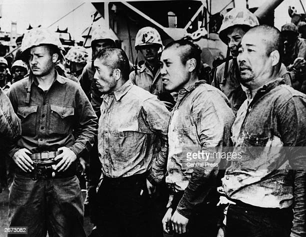 Japanese prisoners of war captured in the battle for Iwo Jima Island in the Volcano Islands in the Pacific Ocean