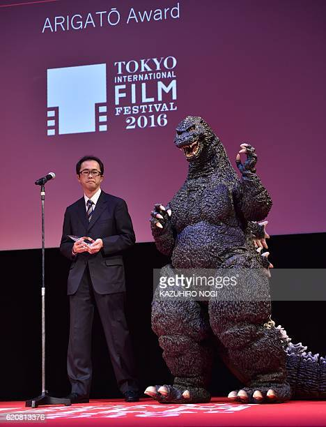 Japanese producer Akihiro Yamauchi and Godzilla celebrate at the award ceremony after winning the Arigato Award at the 29th Tokyo International Film...