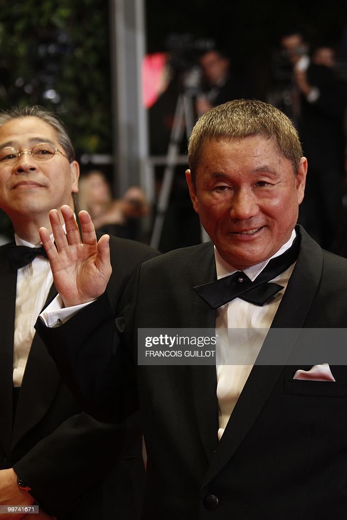 Japanese producer Masayuki Mori and Japanese actor and director Takeshi Kitano (R) arrive for the screening of 'Outrage' presented in competition at the 63rd Cannes Film Festival on May 17, 2010 in Cannes.