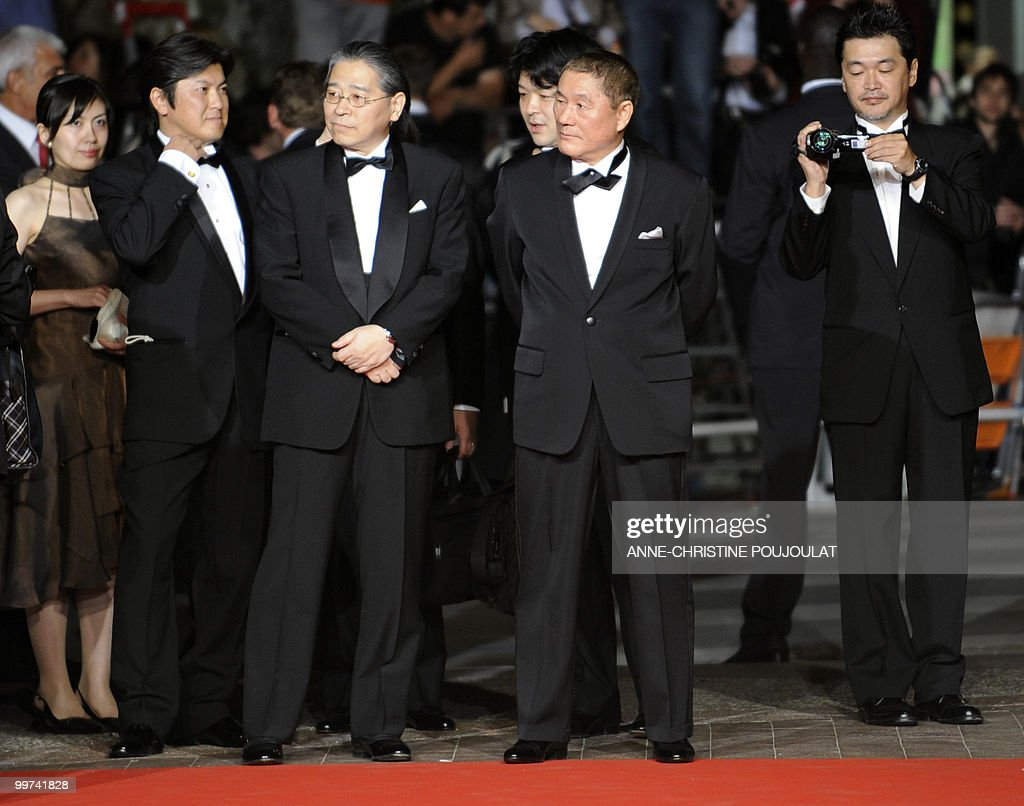 Japanese producer Masayuki Mori (3rdL) and Japanese actor and director Takeshi Kitano (C) arrive for the screening of 'Outrage' presented in competition at the 63rd Cannes Film Festival on May 17, 2010 in Cannes.