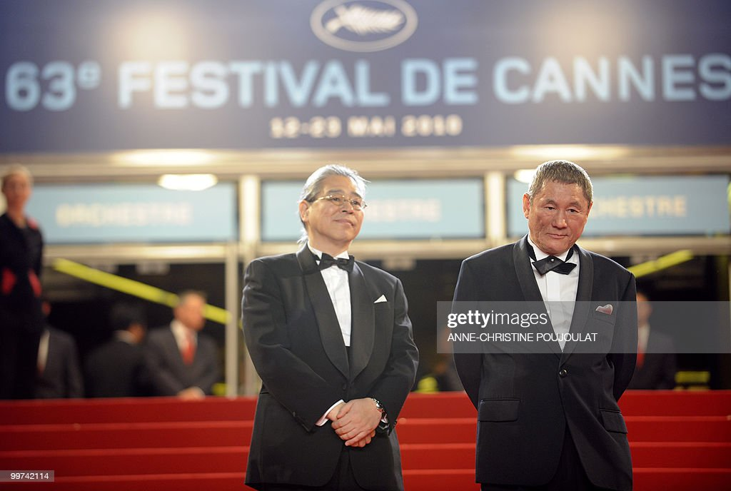 Japanese producer Masayuki Mori and Japanese actor and director Takeshi Kitano arrive for the screening of 'Outrage' presented in competition at the 63rd Cannes Film Festival on May 17, 2010 in Cannes.