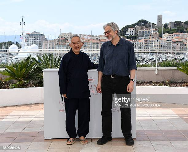 Japanese producer Toshio Suzuki and Dutch director Michael Dudok de Wit pose on May 18 2016 during a photocall for the film 'The Red Turtle' at the...