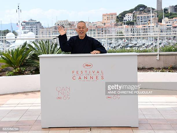 Japanese producer Toshio Suzuki waves on May 18 2016 during a photocall for the film 'The Red Turtle' at the 69th Cannes Film Festival in Cannes...