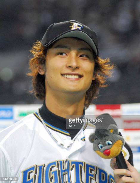 Japanese professional baseball team Hokkaido Nippon Ham Fighters pitcher Darvish Yu smilings during the postgame interview after his win over the...