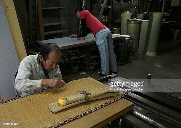 Japanese professional Tatami mat manufacturer Taizo Motoyama and Mitsuru Yokoyama makeTatami at Motoyama Tatami Shop on October 18 2013 in Kyoto...