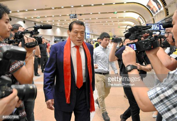 Japanese professional wrestlerturnedlawmaker Antonio Inoki or Kanji Inoki speaks on arrival at Beijing Interenational Airport after his visit to...