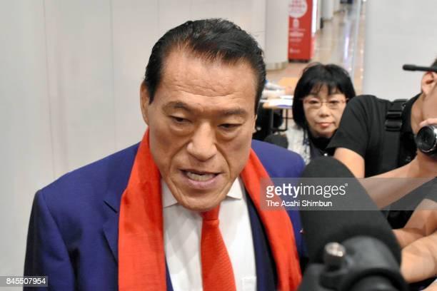 Japanese professional wrestlerturnedlawmaker Antonio Inoki or Kanji Inoki speaks on arrival at Beijing Interenational Airport after his visit to...