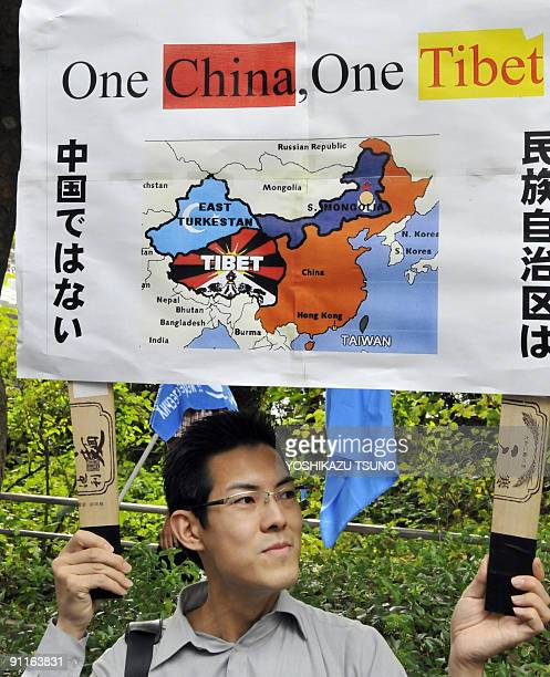 A Japanese proTibet activist holds up a placard during an antiChina demonstration in Tokyo on September 26 2009 Some 200 Tibetans Uighurs Inner...