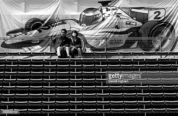Japanese race fans sit in the grandstands practice for the IRL Indycar Series Bridgestone Indy Japan 300 on April 20 2007 at the Twin Ring Motegi in...