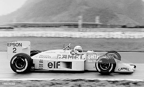 Japanese racing driver Satoru Nakajima drives the Camel Team Lotus Honda Lotus 100T Honda V6 in the 1988 Brazilian Grand Prix in Rio de Janeiro...