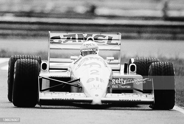 Japanese racing driver Satoru Nakajima drives the Camel Team Lotus Honda Lotus 100T Honda V6 to finish in 6th place in the 1988 Brazilian Grand Prix...