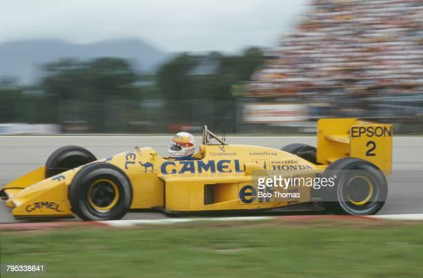 Japanese racing driver Satoru Nakajima drives the Camel Team Lotus Honda Lotus 100T Honda V6 to finish in 6th place in the 1988 Brazilian Grand Prix...