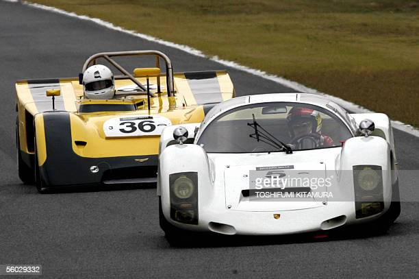 Japanese racing driver Seiji Ara drives his 1966 Porsche 906 Carrera 6 to lead 1971 Chevron B19 during the round one race of class 3 and 4 in the Le...
