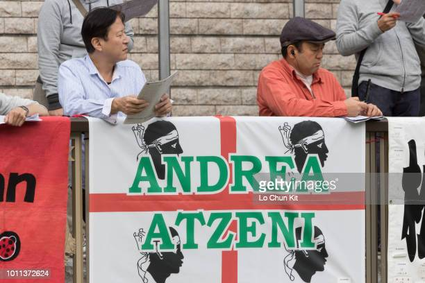 Japanese racing fans put the banner on the rails of the paddock to show support to the jockey Andrea Atzeni at Tokyo Racecourse on November 7 2015 in...