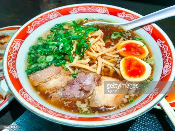Japanese ramen fish stock soup with pork and egg toppings