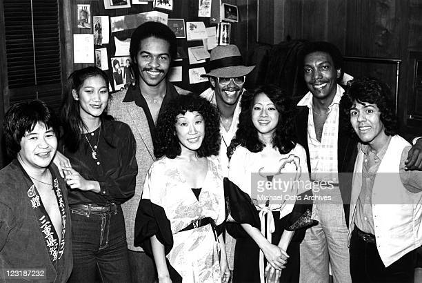 """Japanese recording group Hiroshima poses backstage at the Roxy Theatre with musician Ray Parker, Jr. Of """"Raydio"""" on January 23, 1980 in Los Angeles,..."""