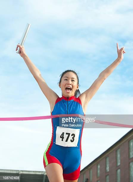 Japanese relay runner winning race