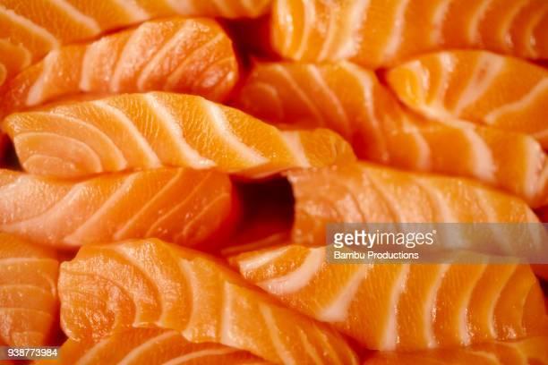 japanese restaurant showcase with fresh salmon - sashimi stock pictures, royalty-free photos & images