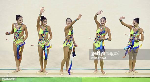 Japanese rhythmic gymnasts Sakura Noshitani Rie Matsubara Kiko Yokota Airi Hatakeyama and Sayuri Sugimoto acknowledge the audience after performing...