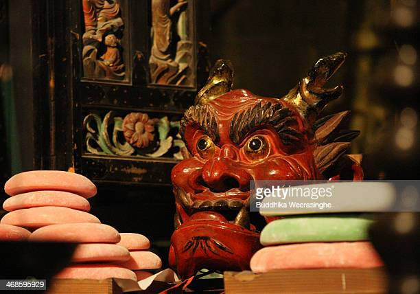 Japanese rice cake Mochi offer to traditional mask named AkaOni red devil during the Oni Oi annual festival at Masuiyama Zuiganji Temple on February...