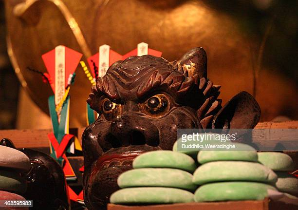 Japanese rice cake Mochi offer to traditional mask named AoOni blue devil during the Oni Oi annual festival at Masuiyama Zuiganji Temple on February...