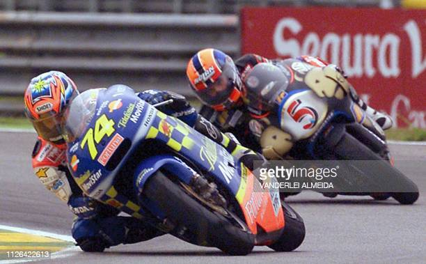 Japanese rider Daijiro Katoh 2001 FIM Road Racing Champion powers his Honda followed by Marco Melandri on Aprilia during the 250cc Rio's GP race 03...