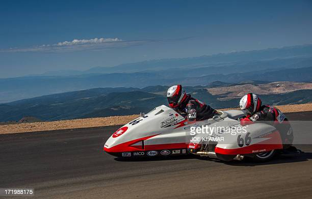 Japanese rider Masahito Watanabe and his copilot cross the finish line at the summit of Pikes Peak mountain during The Pikes Peak International Hill...