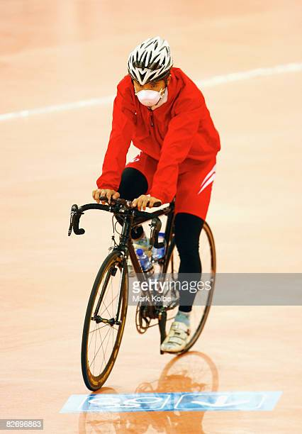Japanese rider wearing a mask over his face warms up during the Track Cycling event during the 2008 Beijing Paralympics at Laoshan Velodrome on...