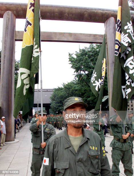 Japanese rightwing demonstrators stand at attention at Yasukuni Shrine where Japan's casualties of World War II including executed war criminals are...