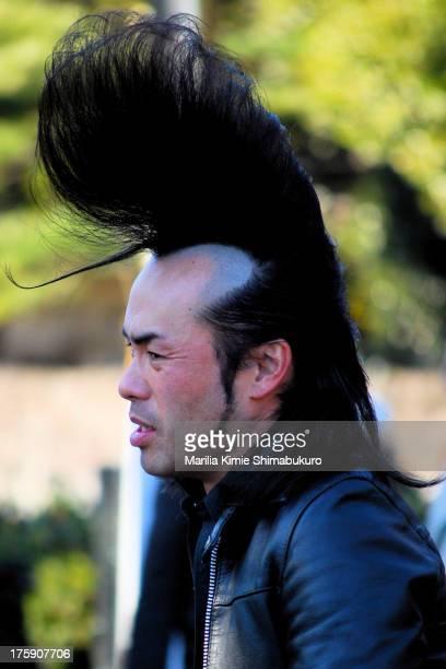 Japanese rockabilly dancer showing off an impressive hairdo at yoyogi park in Tokyo.