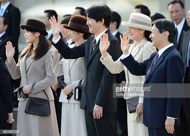 Japanese royal family members Princess Mako Princess Kiko Prince Akishino Crown Princess Masako and Crown Prime Naruhito see off the plane on which...