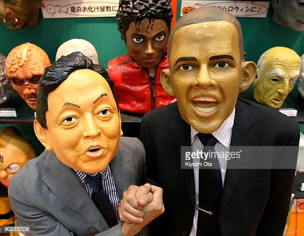 Japanese rubber mask maker Ogawa Rubber Inc. President Hirohisa Ogawa and Executive Director Takahiro Yagihara wear rubber masks of Japanese Prime...