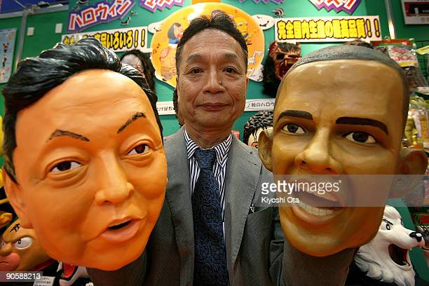 Japanese rubber mask maker Ogawa Rubber Inc. President Hirohisa Ogawa holds rubber masks of Japanese Prime Minister-elect and President of the...