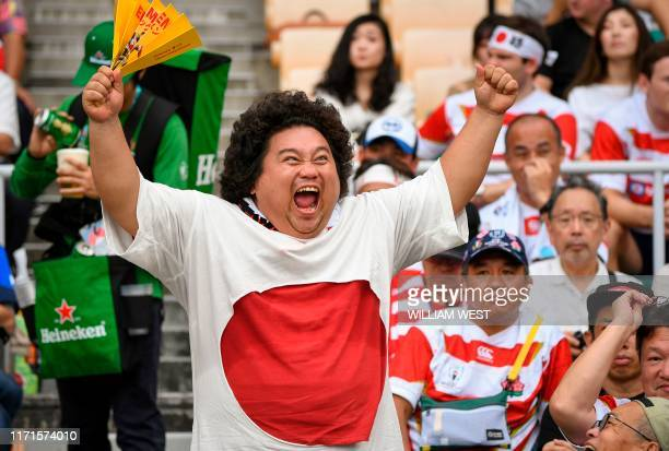 A Japanese rugby fan is seen cheering in the stand prior to the Japan 2019 Rugby World Cup Pool A match between Japan and Ireland at the Shizuoka...