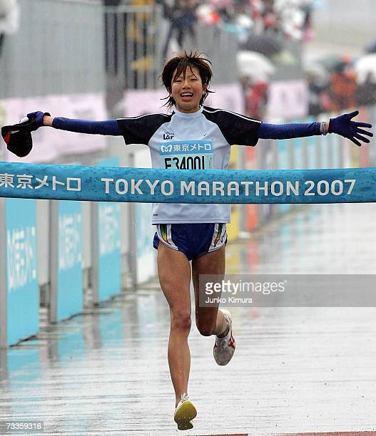 Japanese runner Hitomi Niiya crosses the finish line during the Tokyo Marathon 2007 on February 18 2007 in Tokyo Japan Niiya is the female winner of...