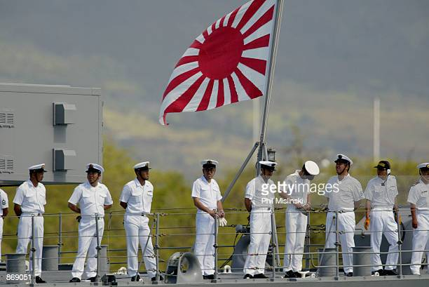 Japanese sailors aboard the JDS Hamagiri man the rails as the ship departs from Pearl Harbor to begin RIMPAC 2002 exercise operations June 28, 2002...