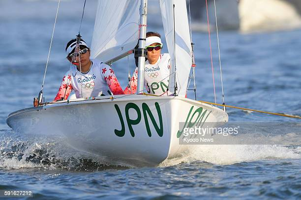 Japanese sailors Ai Yoshida and Miho Yoshioka are towed back to port after the women's 470 sailing medal race was postponed due to lack of wind at...