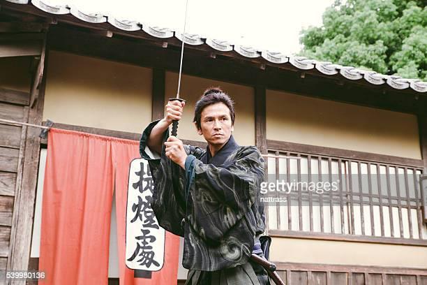 Japanese Samurai arms himself ready for battle