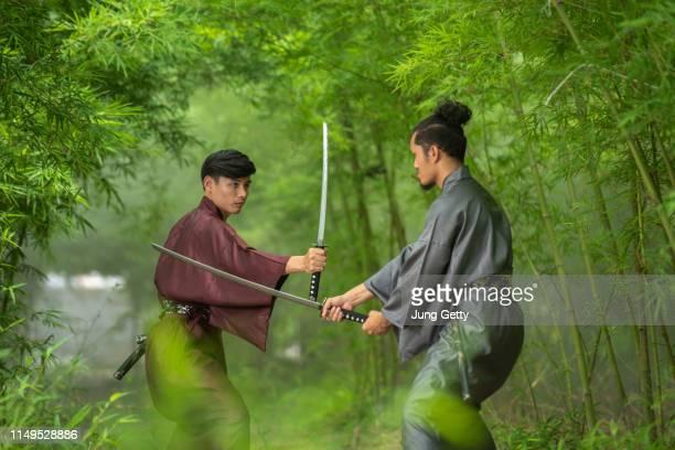 japanese samurai fighter wearing traditional uniform - samurai stock pictures, royalty-free photos & images