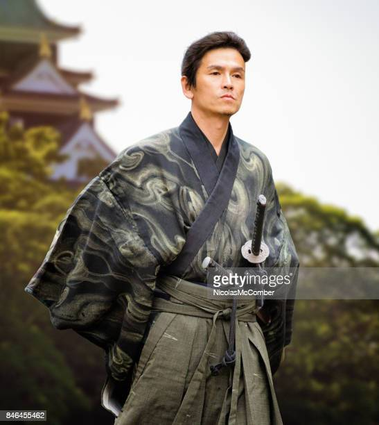 japanese samurai in costume standing in front of edo building - obi sash stock pictures, royalty-free photos & images