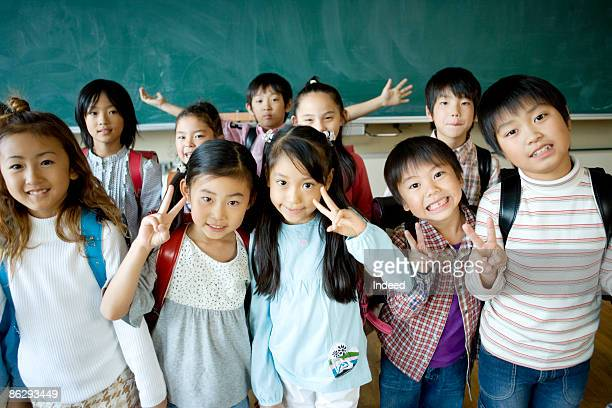 Japanese school children smiling in classroom