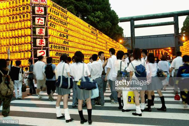 Japanese school children visit the Yasukuni shrine decorated with paper lanterns where more than 24 million wardead are enshrined on July 16 2004 in...