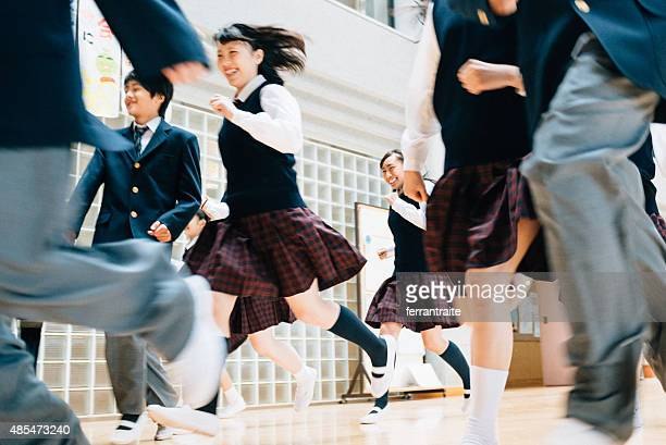 japanese school girl racing the boys to recess - highschool stock photos and pictures