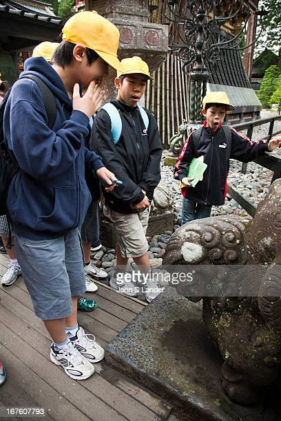 Japanese school kids on excursion at Toshogu Shrine built in 1617 as the mausoleum of the Tokugawa Ieyasu The main shrine buildings were built by the...