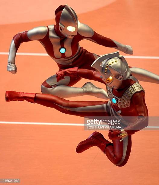 Japanese Science and Fiction charactors Ultra Seven and Ultraman perform during the men's volleyball qualifying tournament match between Japan and...