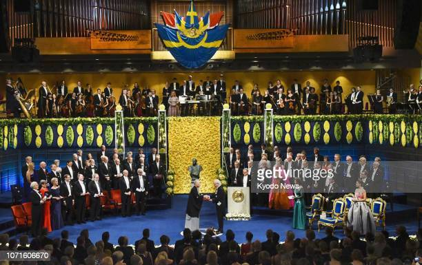 Japanese scientist Tasuku Honjo receives the Nobel Prize in physiology or medicine from Swedish King Carl XVI Gustaf during a ceremony in Stockholm...